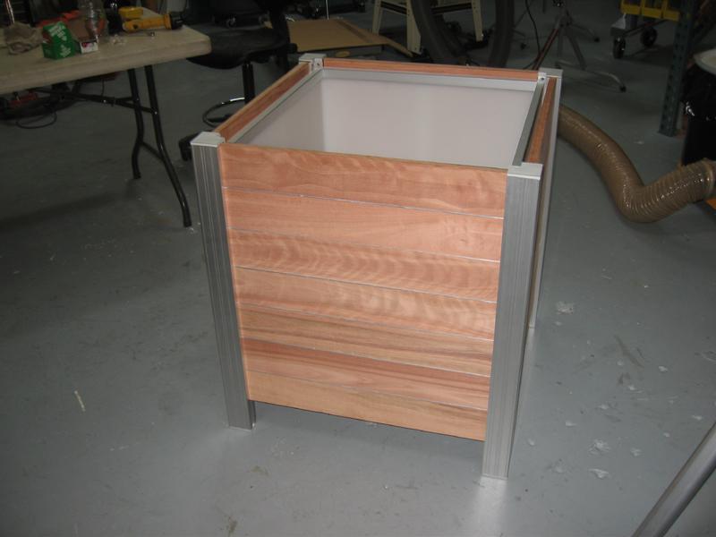 Custom wood aluminum planter houses a stereo speaker