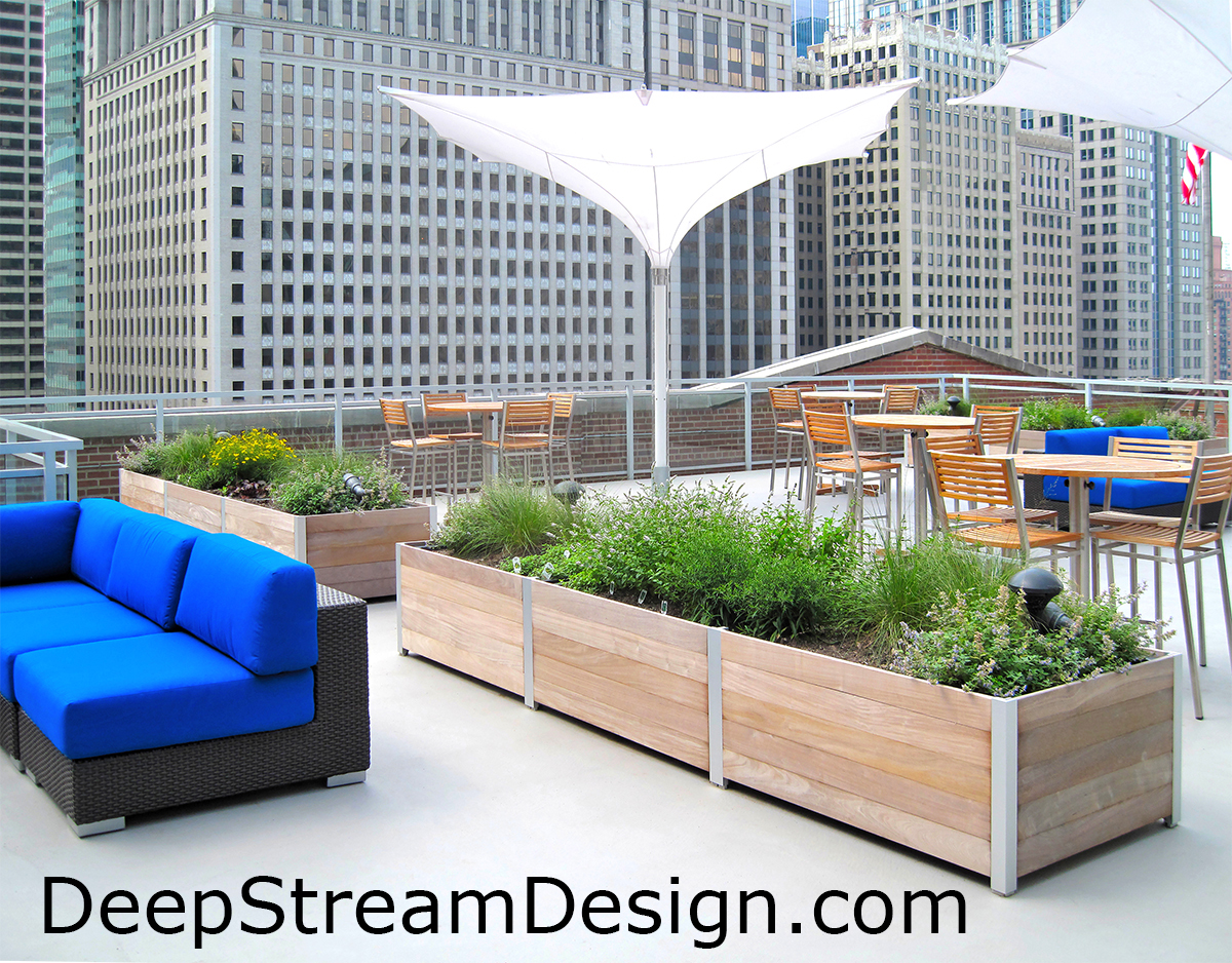 Commercial Wood Planters, with rugged recycled plastic waterproof liners, on the roof deck of a Chicago restaurant create green dining and lounging areas with an herb garden for the kitchen. Click for more info