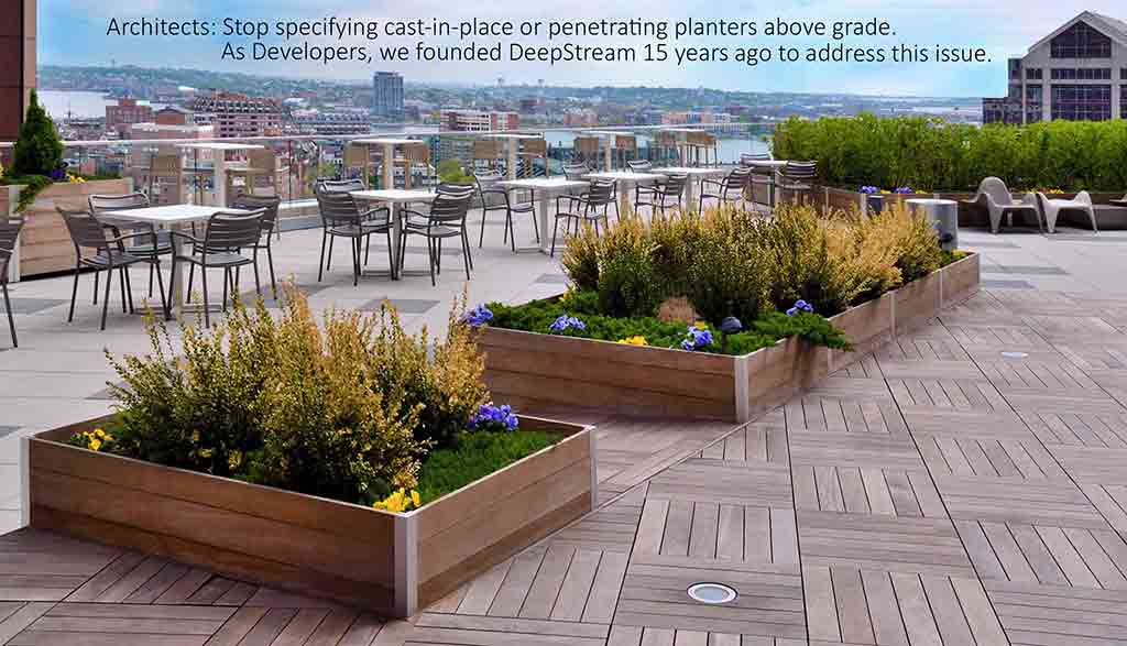 Large rooftop deck commercial wood planter system atop a highrise roof deck overlooking Boston harbor.