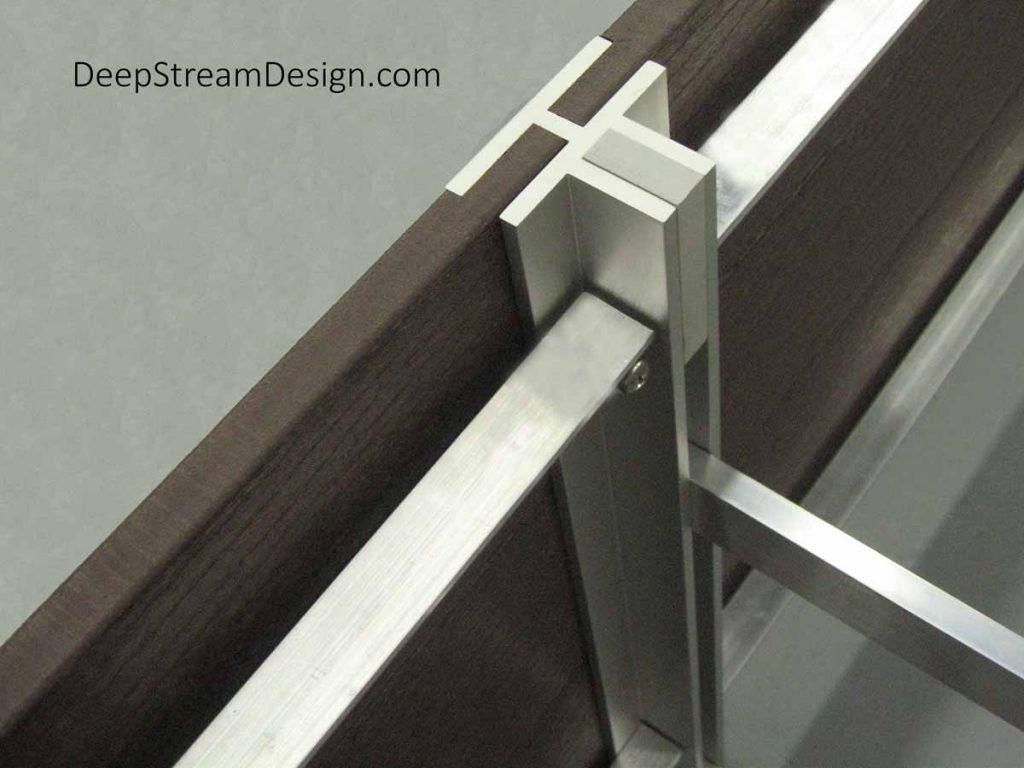 DeepStream Proprietary trademark Mariner T marine anodized aluminum extrusion used to join 2 modular planters to create long planters.