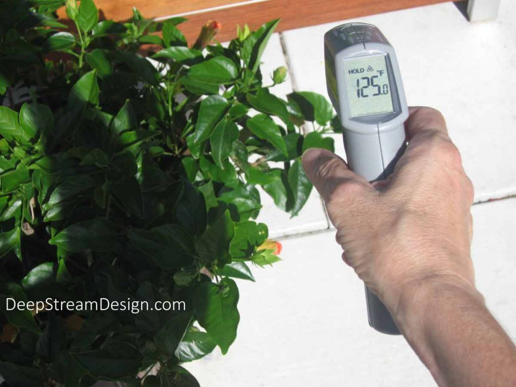 The temperature reading on a thermal gun shows a reading of 125 degrees fahrenheit for the outside of a planter on a sunny 80 degree day.